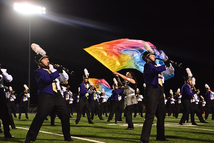 Members+of+marching+band+performs+a+song+from+their+theme+%22Iconic%3A+Crossing+Generations%22.+The+marching+band+performed+during+the+half-time+show+Oct.+2.