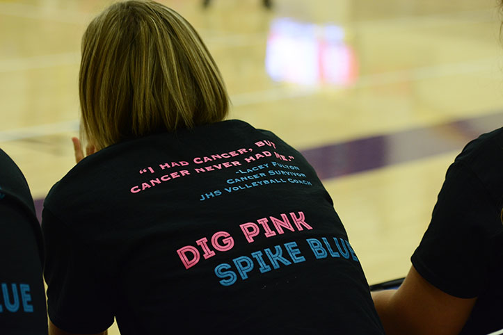Assistant varsity volleyball coach Lacey Fulton is sporting her Dig Pink/ Spike Blue shirt during the Dig Pink/ Spike Blue game against Urbandale. Fulton will be recognized on Nov 13. before the Class 5A girls' state volleyball title game.