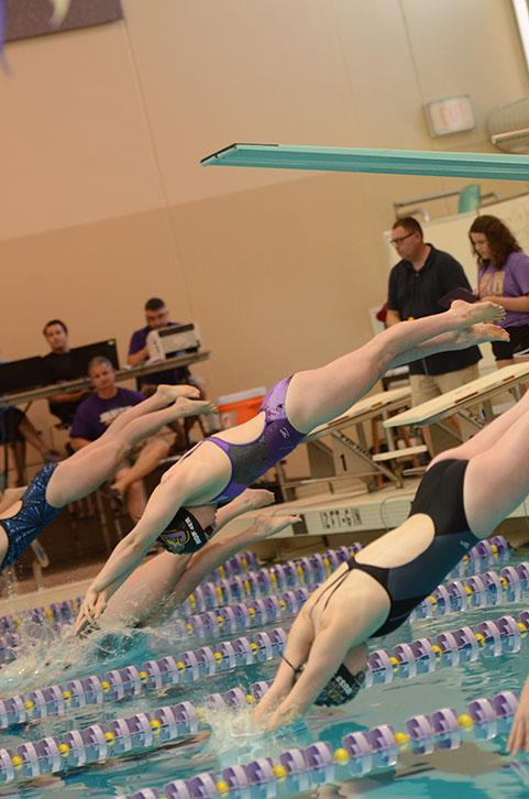 Junior Lexi Horner dives into the water for the 100 yard breaststroke at the Johnston Invitational Oct. 10. She placed first in the event with a time of 1:07.47 minutes, Horner has broken multiple school records and obtained all 14 honor times.