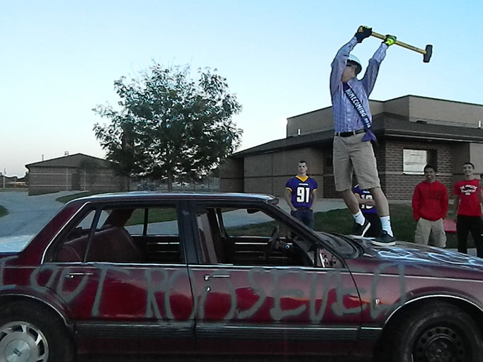 Sophomore, Josh Marskmann is getting ready to drop the hammer at the Car Smash. The Car Smash took place near the baseball fields at 6:30 p.m. on Oct. 1. The cost of one swing at the car was $1 and for six swings the price was $5.