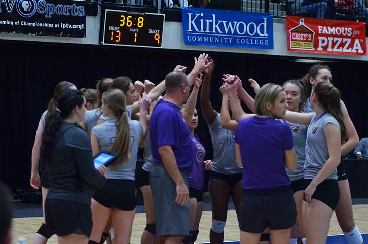 During a the first set head coach Rick Brooks calls for a timeout with the whole team. The girls' varsity volleyball team ended their season against the Ankeny Centennial Jaguars Nov. 10.