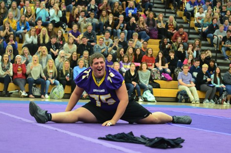 Amazing the spectators junior Bryce Rowland ends the pep rally with the splits, the varisty football team's surprise. The football team will be playing the third play off game against the Valley Tigers Nov. 6.