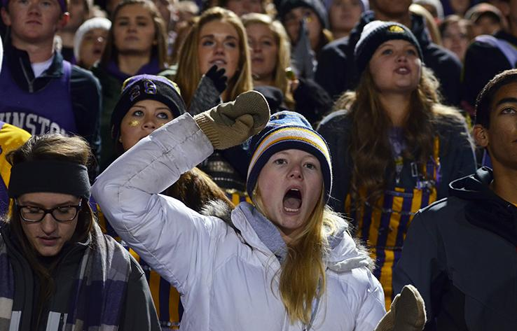 Senior Bailey Knopf yells towards the players on the field. The varsity football team played the third playoff against the Valley tigers Nov. 6.