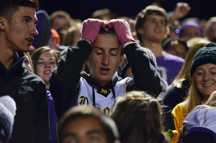 During the last few minuets of the fourth quarter senior Nicholas Handstad places his hands on his forehand with worry. The varsity football team played the third playoff against the Valley tigers Nov. 6.