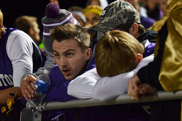 Senior Mike Rolloff glances up to watch the last minuet of the game while senior Cade Wagner anxiously keeps his head down. The varsity football team played the third playoff against the Valley tigers Nov. 6.