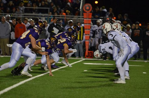 The Dragons' defensive line rushes to tackle Valley Tiger's offensive line during the final round of State playoffs Nov. 6. The Dragons lost to the Tigers 20-17.