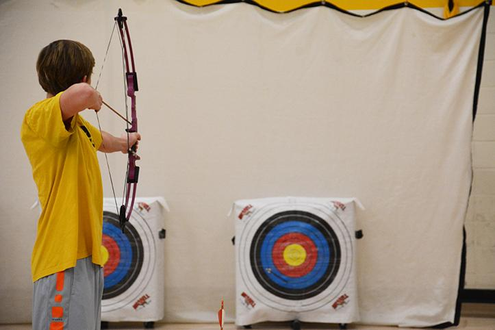 Sophomore Robby Chickering prepares to shoot an arrow at a target a few meters away during Track 2 P.E. Before Chickering and the rest of the class went up to shoot, Mennen gave instructions on whistle commands and how to shoot correctly.
