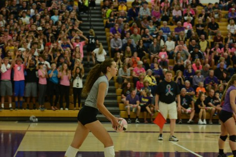 Junior Taryn Knuth prepares to serve at the Dig Pink Spike Blue volleyball match on September 29. Knuth, who was named 1st team all conference and 1st team all division this school year, signed to play Division I volleyball at Florida State University.