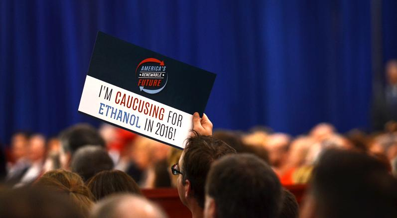 An audience member holds up a sign promoting their interest in ethanol. Trump made negative remarks towards republican candidate Ted Cruz's ethanol policies.
