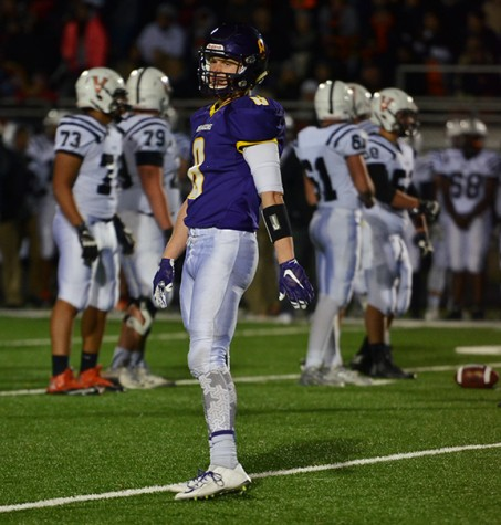 Senior Karl Rasmussen stands towards the sideline while looking out to the crowd. Rasmussen recently was awarded the Iowa Bankers Association student athlete award.
