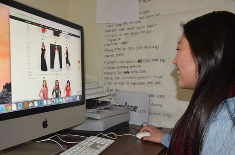 Senior Makenzie Hill scrolls through just a few of the hundreds of dresses sold online from Lulus.com. Websites similar to Lulu's that sell an assortment women's clothing are becoming more popular in today's era of cyber shopping.