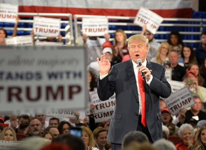 Trump address the crowd at his rally. He made a speech then answered questions from various invited interest groups, including the AARP, Tea Party Patriots, Veterans for Strong America, America's Renewable Future, Iowa Pays the Price and Rural Electric Cooperatives. The townhall-style rally took place Dec. 11 at the Iowa State Fairgrounds.