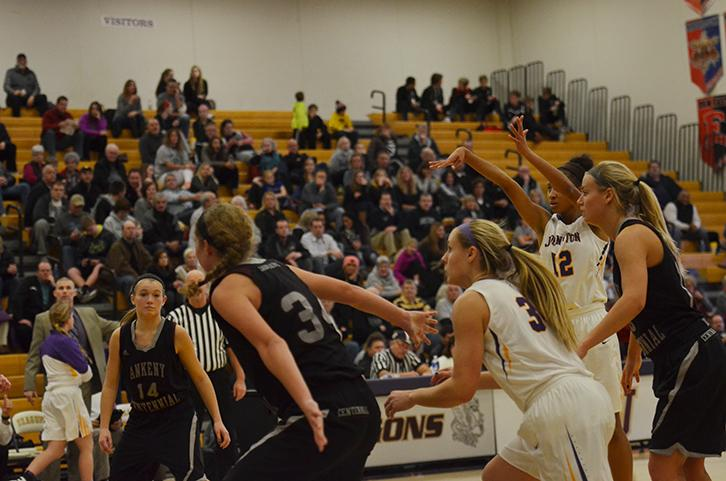 Junior Elle Brown follows through on her free throw shot while Ankeny Centennial players prepare to get the rebound. Brown shoots 81.8 percent at the free throw line. The girls won 61-41 Jan. 5.
