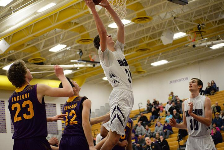Junior Dawson Jones successfully dunks the ball scoring two points for the team. The Dragons defeated the Indians on Jan. 26.