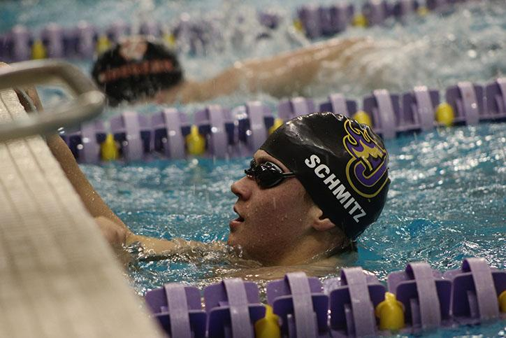 Freshman+Michael+Schmitz+completes+his+100+meter+length+in+the+Mens%27+400+relay.+The+boys%27+swim+team+will+compete+again+at+home+Jan.+23+at+11%3A00+a.m.