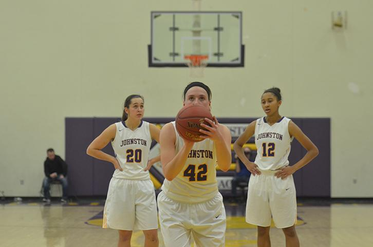 Senior Rachel Hinders lines up her shot at the free throw line. Hinders went 10-10 at the free throw line, and was the team's leading scorer with 18 points.