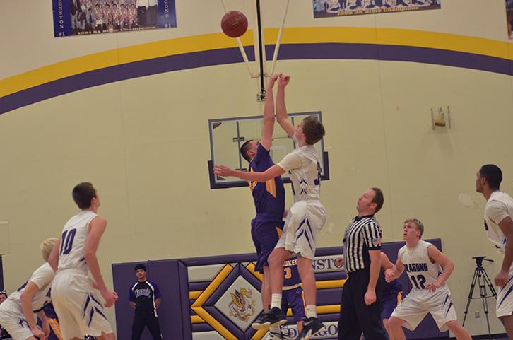 Going+against+his+Waukee+opponent+junior+Dawson+Jones+jumps+up+for+the+rebound+before+his+opponent+can+get+to+it.+The+boys%27+varsity+basketball+team+lost+against+Waukee+Jan.+12+with+a+close+game+98-105+.