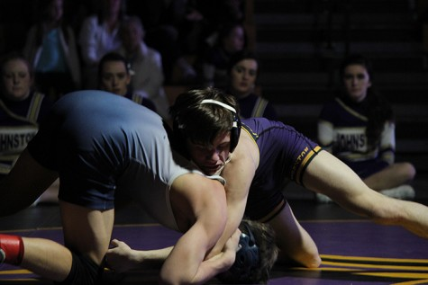 Senior Blake Anderson attempts to take down an opponent. Anderson currently wrestles for the varsity team in the 113 weight class.