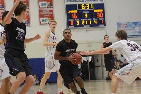 Junior Jeran Proctor drives through the Urbandale defense to the basket. The Dragons defeated the Jayhawks  Jan. 29.