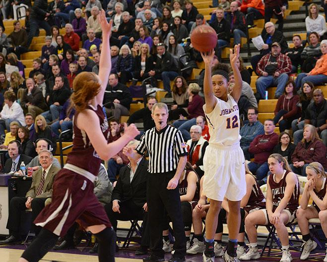 Junior Elle Brown shoots a three-pointer. The girl's defeated the Maroons Feb. 5.