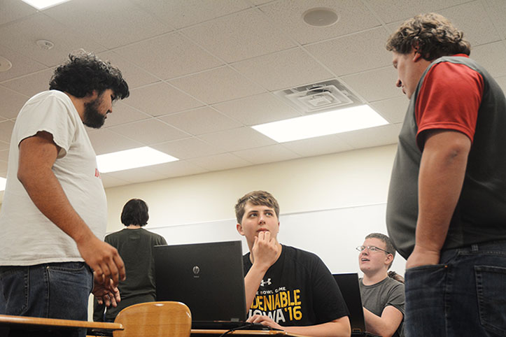 Senior Yash Gupta,  junior Grayson Haggett converse with Technology Specialist Ryan Witt about Hyperstream. The club met Feb. 16 to work on computers in Computer Science teacher Justin Lewis's room.