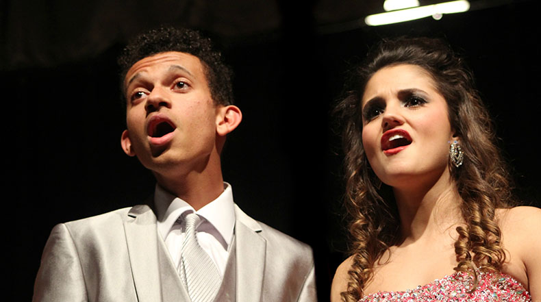 Seniors Dewann Stone and Sophia Cresta sing during Innovation's performance at the show choir student show. Innovation's director, Hannah Ryan is being nominated for a