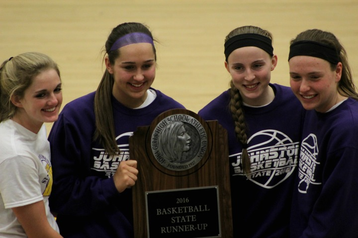 Seniors Julia Beswick, Haylee Towers, Shayna Stubbs and Rachel Hinders present the trophy for the 2016 girls' basketball state runner up. The girls' basketball team ended the year with a 22-4 record overall.