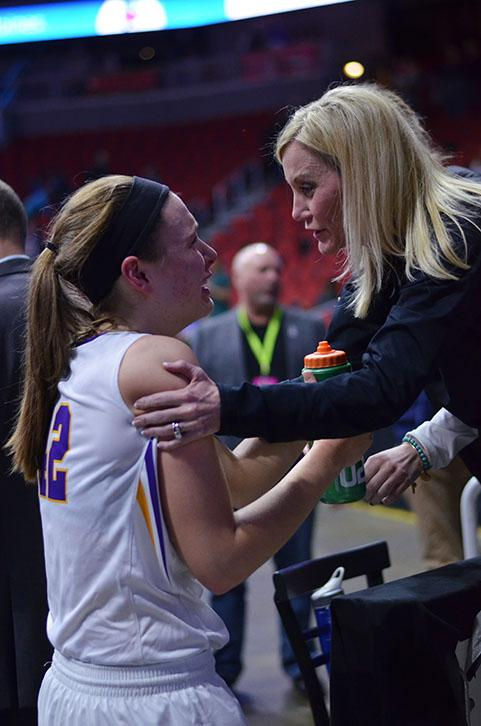 After the loss against Ankeny Centennial, senior Rachel Hinders is comforted by her mom. The Dragons lost the game 46-42.