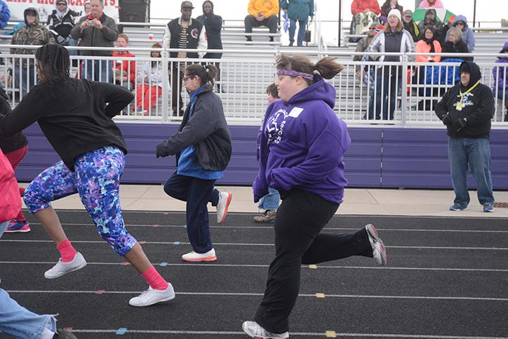 Sprinting in her event senior Miranda Kerr participates in the 50 meter dash. The Special Olympics were held April 5 at Indianola High School.