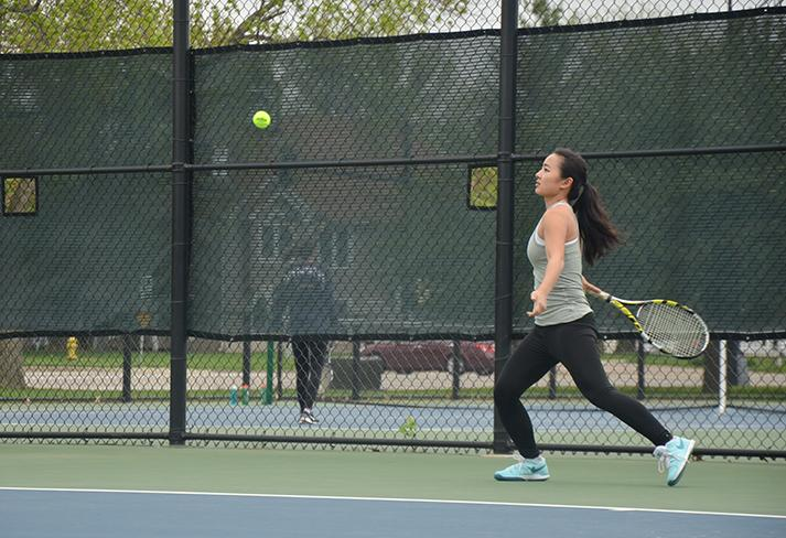 Preparing to hit an incoming ball junior Xiao Liu participates in a singles match. The team won 10-1 against the SE Polk Rams April 28.