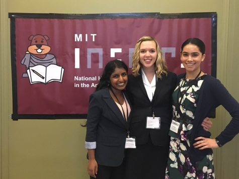 Rivett smiles with friends she met at the MIT conference.