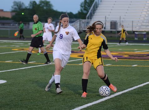 Working to defend the Dragons' side of the field senior Shayna Stubbs studies a way to get the ball. The Dragons played against the Rams May 10 winning 2-1.