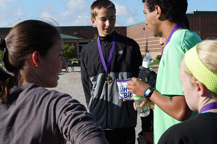 After completing the race second place finisher sophomore Carsten Thompson converses with winner junior Allan Juarez. Juarez finished with the fastest time and the Yelps dedicated songs to his victory.