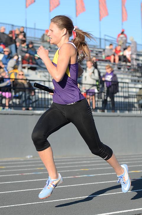 Anna+Roshek+sprints+for+the+relay+handoff+at+Ames+high+school+during+the+girls%E2%80%99+track+meet.+Johnston+placed+third+overall+on+April+4th+2016.