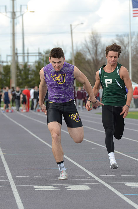 Junior Jonny Pater finishes the 100m sprint. Pater placed 13th in the 100m sprint at the state track meet May 19.