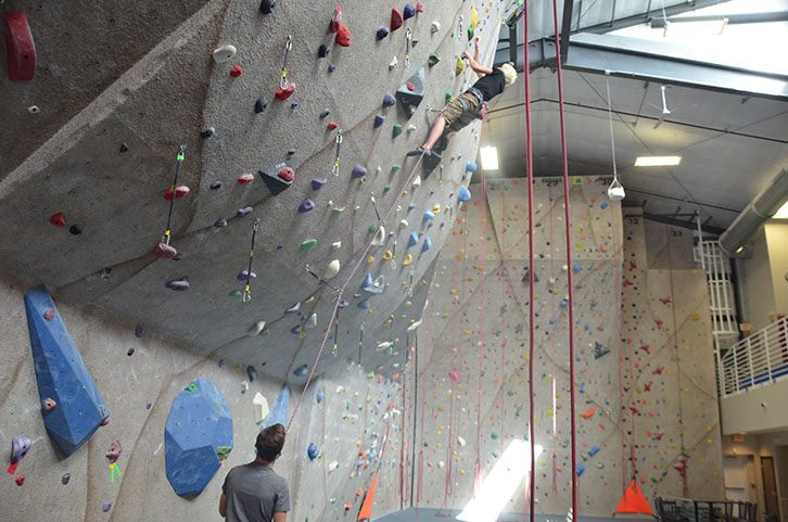 Reagan Lehmen '19 holds the rope for Carson Jendro '18 as he lead climbs. Both Lehmen and Jendro climb competitively.