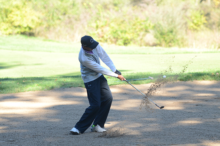 Akansh+Gupta+%2718+attempts+to+get+his+ball+out+of+the+sand+bunker.+The+boys%27+golf+team+competed+at+state+in+Polk+City%2C+Oct.+7-8.