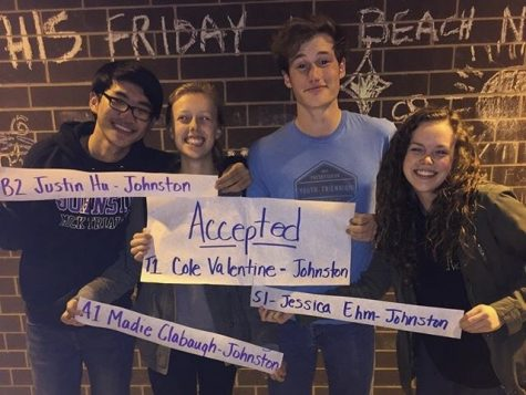 Justin Hu '17, Madie Clabaugh '17, Cole Valentine '17 and Jessica Ehm '17 celebrate after seeing the results of the All State auditions. Auditions were held Oct. 22 in Indianola.