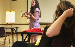 Professor Amber Bellville teaches prospective business women the basics of supply chain management.