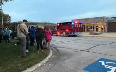 Students and staff wait as firemen inspect the building to make sure it is safe for them to return inside. They were stuck outside for 17 minutes after a fire alarm was set off.