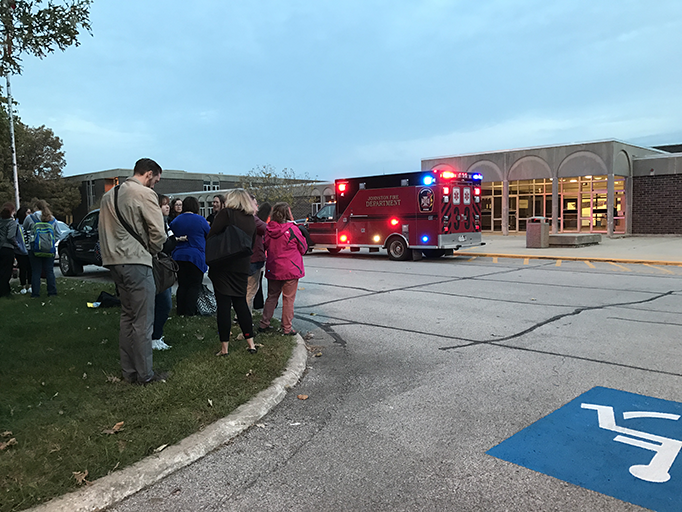 Students+and+staff+wait+as+firemen+inspect+the+building+to+make+sure+it+is+safe+for+them+to+return+inside.+They+were+stuck+outside+for+17+minutes+after+a+fire+alarm+was+set+off.