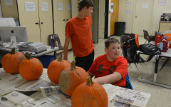 Juniors Jacob Anderson  and Jack Marren prepare to carve pumpkins. Art club sponsered the event Oct. 21.