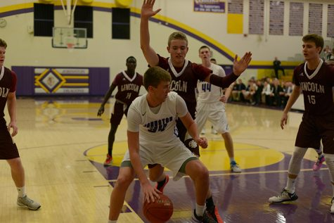 Varsity boys' basketball takes victory against East