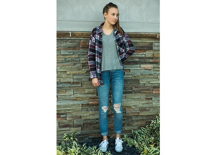 Whether you tie it around your waist or wear it loosely over a blouse, a flannel shirt is the most universal fashion statement on the market.