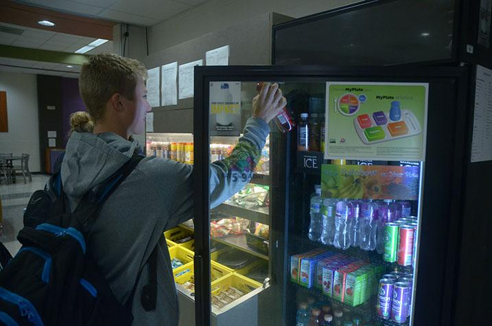 Owen Ness '19 grabs a drink from the cafeteria before starting the school day. Many students started their day off in the cafeteria, either getting something to eat and/or drink for breakfast, or just to hang out with friends.