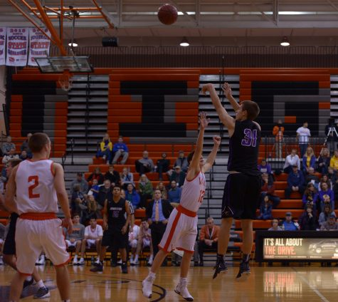 Camden VanderZwaag'18 completes a shot over a defending Valley player. The boys play next Friday, Dec 9. at home.