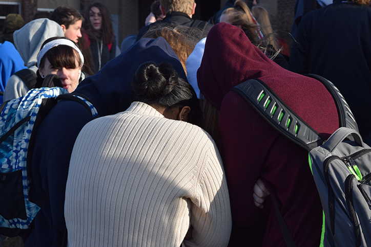 Students huddle to preserve body heat during the fire alarm. Students were forced outside Dec. 8 after the alarms went off.