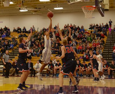 Jaden+Kephart%2717+leaps+over+an+urban+dale+player%27s+hands.+The+boys+defeated+the+Urbandale+J-Hawks+71-47+Friday%2C+Dec+16.