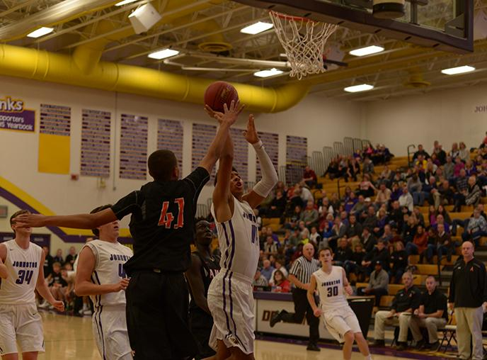 Jaden Kephart' 17 goes for a lay-up against an Ames opponent. The Dragons lost to Ames 55-48 Dec 2.