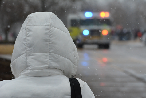 A student looks to the fire truck as it pulls up to investigate the fire alarm. The fire alarm went off during B Lunch, sending students and staff outside into the snow.
